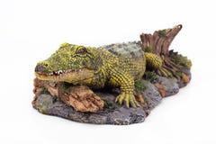 Staty av en krokodil Arkivfoton