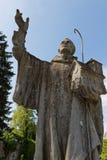 Staty av en munk i den Citeaux abbotskloster Arkivfoto