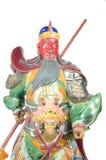 Staty av Guan Yu (gud av heder) på vit bakgrund Royaltyfri Foto