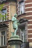 Staty av hantverkaren på staketet Sablon Park Arkivfoto