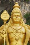 Staty av Lord Murugan som de Batu grottorna hänrycker i Kuala Lumpur, Malaysia Arkivbilder