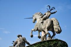Staty av Neptun med en lyftt hand som rymmer en treudd, i Get Royaltyfri Bild