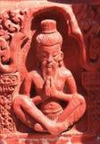 Staty av rishien Arkivbild