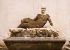 staty för babuinoil rome Arkivfoto