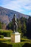 Staty för lovsång I på den Peles slotten Arkivfoto