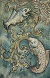 Staty för två fisk på väggen. Arkivfoton