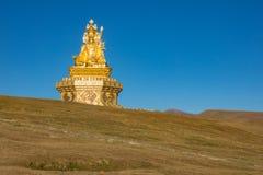 Staty på kullen i den Yarchen garen, Kina Royaltyfria Bilder
