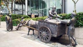 Staty på vägrenen i Singapore Arkivfoto