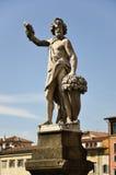 Staty som föreställer hösten, broSt. Trinita, Florence 2 Arkivbild