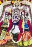 Statyer av de indiska gudarna Brahma Vishnu Durga Shiva Ganesha som göras med blommor för den Masi Magam festivalen fotografering för bildbyråer