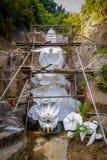 Statyer på tio tusen Buddhakloster i Sha tenn, Hong Kong, Kina Arkivfoton