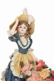 Statyett av flickan med skottkärran som är full av blommor Arkivbilder