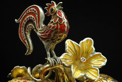 Statyett - hane av gulden Royaltyfri Foto