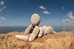 Statyett på stranden Royaltyfri Bild