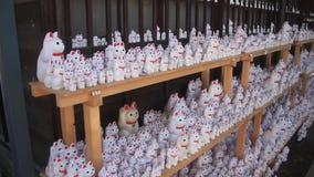 Statykatt på Gotokuji i Tokyo stock video