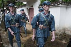 Statyn av a-gruppen av soldater för röd armé som korsar byn i den Parkï för röd armé ¼en Œshenzhen, porslin Royaltyfria Bilder