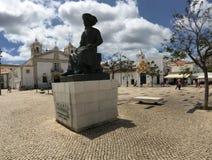 Statyn av Infante D Henrique Arkivfoton
