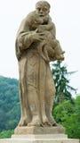 Statyn av konungen St med behandla som ett barn Royaltyfria Foton