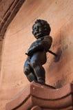 Statyn av manneken pis royaltyfri foto