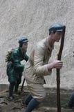 Statyn av soldaten Climbing med pinnen i den Parkï för röd armé ¼en Œshenzhen, porslin Arkivfoton