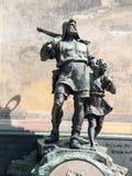 Statyn av William berättar och hans Son Walter Arkivfoto