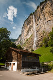 Staubbach Falls with building, Switzerland Stock Photos