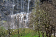 Staubbach waterfall in Lauterbrunnen Switzerland in spring. View at the famous Staubbach waterfall in Lauterbrunnen in Berner Oberland in Switzerland in spring royalty free stock image