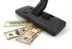 Staubsauger und Geld Stockbilder