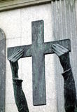 Staue Hands Holding Cross Stock Photo