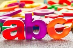Stava för abc och hög av plast- bokstäver Fotografering för Bildbyråer