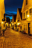 Stavanger at night. White wooden houses classic architecture in the old part of Stavanger, Norway Royalty Free Stock Photos