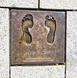STAVANGER, NORWAY - JULY 09, 2015: Bronze cast of bare feet of Desmond Mpilo Tutu, Nobel Peace laureate in Stavanger, Norway. Royalty Free Stock Images