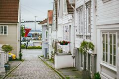 Street with white wooden houses in old centre of Stavanger, Norway