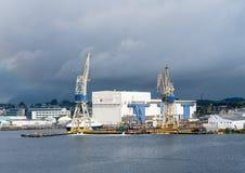 Rosenberg shipyard in Stavanger Harbor. STAVANGER, NORWAY - SEPTEMBER 20, 2017: Oil rig construction company and shipyard Rosenberg in Stavanger Harbor stock photography