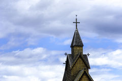 Stave Church Detail in the Sky. The top of the famous stave church in Heddal with clouds in the sky Royalty Free Stock Image