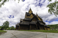 Stave Church at Heddal with Sky. Dramatic sky above the stave church of Heddal in Norway Stock Photography