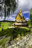 The Stave Church in Heddal. A view of the church in Heddal, his yard and cementary Stock Images