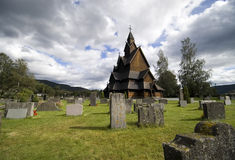 Stave church, Norway. A traditional Norwegian church made of wood only, called 'stavkirke', Cemetery surroundings Stock Photo