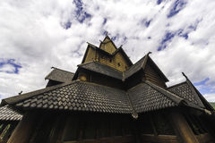 Stave Church in the Sky. Dramatic sky above the stave church of Heddal in Norway Stock Photos