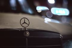 STAVROPOL, RUSSIA - 01.02.2015 - logo and badges on a old white vintage Mercedes car. royalty free stock photos