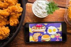 Smartphone with mobile application. Stavropol, Russian Federation. June 10, 2019. Smartphone with mobile application Breakfast Food Adventure For royalty free stock images