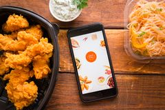 Smartphone with mobile application. Stavropol, Russian Federation. June 10, 2019. Smartphone with mobile application FoodFun royalty free stock images