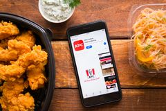Smartphone with mobile application. Stavropol, Russian Federation. June 10, 2019. Smartphone with mobile application KFC online Food ordering stock image