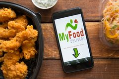 Smartphone with mobile application. Stavropol, Russian Federation. June 10, 2019. Smartphone with mobile application MyFood.Delivery royalty free stock photo