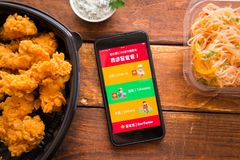 Smartphone with mobile application. Stavropol, Russian Federation. June 10, 2019. Smartphone with mobile application StarTaster ChineseFoodDelivery royalty free stock photos