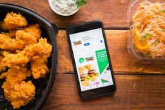 Smartphone with mobile application. Stavropol, Russian Federation. June 10, 2019. Smartphone with mobile application 864ToGo-Food Delivery stock photography
