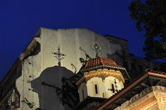 Stavropoleos monastery details - night scene. Two streets in the old city center of Bucharest joining on the corner of the oldest church in town - night scene Stock Photography