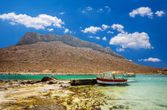 Stavros beach on Crete island, Greece. Fishing boats waiting in Stavros bay Stock Images