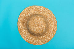Staw hat on a blue background. Staw hat on a bright blue background royalty free stock photo