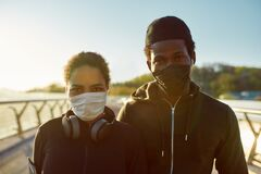 Free Stay Active During Quarantine. Young African Couple In Medical Masks Looking At Camera After Running Together On The Royalty Free Stock Photo - 183371775